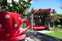 Relax in the rear gardens of Nest Haven Bed and Breakfast accommodation Napier NZ